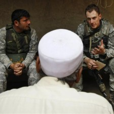 Lieutenant Cumbie of the U.S. Army's Dagger Company, 2-12 IN, 4th Bgd talks to a village elder in Kolack in the Pesh Valley